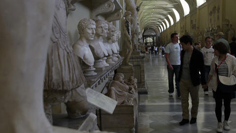 Tourists walk up and down the Gallery of Busts at the Vatican, including a coupl Footage