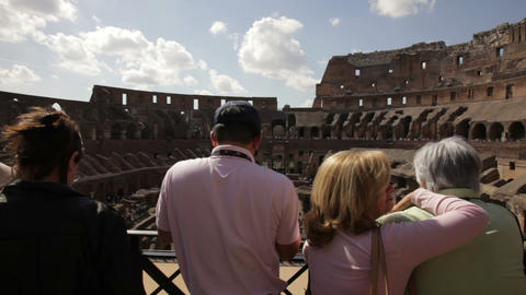 Tourists gazing from balcony to the bottom of the Colosseum Footage
