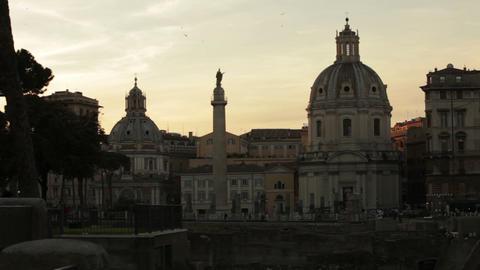Santissimo Nome di Maria al Foro Traiano with Santa Maria di Loreto at dusk Footage
