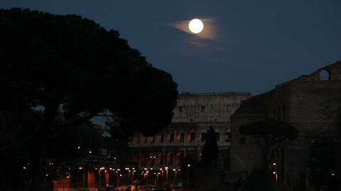 Amazing full moon over the Roman Colosseum Footage