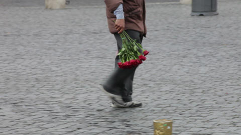 Rome - MAY 8 Man trying to sell umbrellas and red roses on the street Live Action