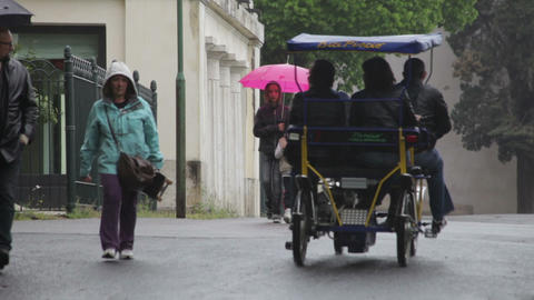 Tourists traveling down a rainy road in Rome Footage