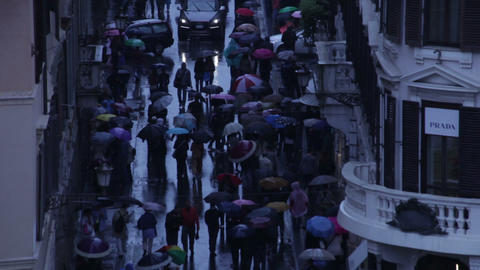 High tilt shot of the crowded Via dei Condotti Footage