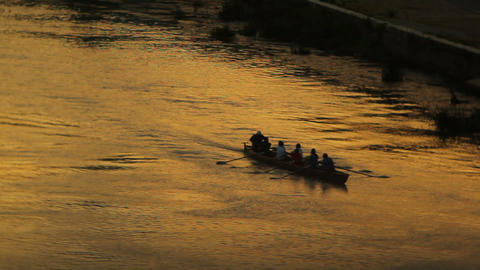 A crew rows down the Tiber River Footage