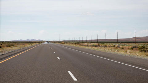 Time lapse down a straight desert highway Footage