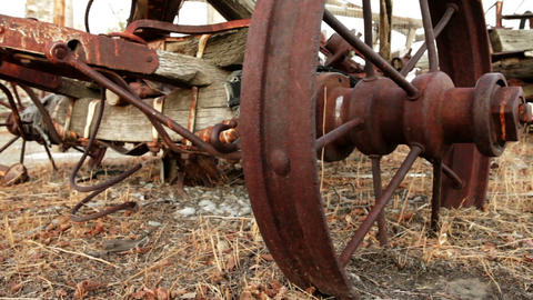 Old, rusted plow abandoned in a field Footage