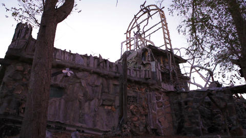 Tall tower above old building at Thunder Mountain Park, NV Footage