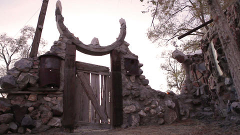 Wooden gate in the stone wall at Thunder Mountain Park in NV Footage