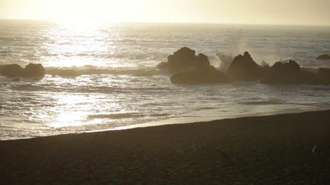 Evening waves crashing on rocks Footage