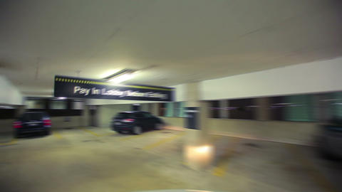 Car enters parking garage Footage