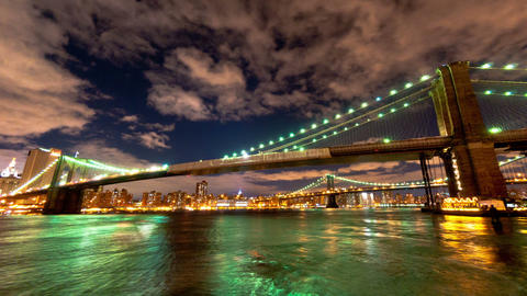 Panning shot of Brooklyn and Manhattan Bridge and the New York City skyline time Footage