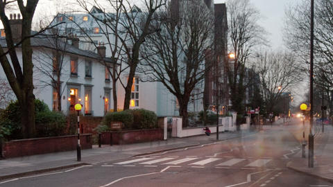 Panning time-lapse of traffic at Abbey Road in London Footage