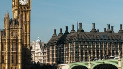 Panning time-lapse of traffic crossing Westminster Bridge by Houses of Parliamen Footage