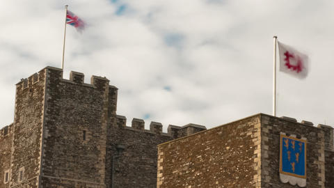 Time-lapse of flags blowing over Dover Castle. Cropped Footage