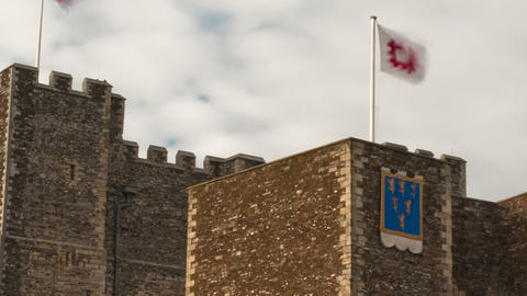 Panning time-lapse of flags blowing over Dover Castle Footage
