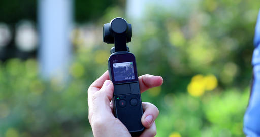 Woman Holding In Her Hand A DJI Osmo Pocket Camera Live Action