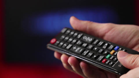 Men's hand. Big remote control is faulty In his right hand. Green screen. Press Footage