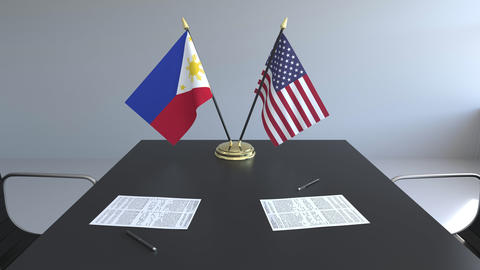 Flags of Philippines and the United States of America and papers on the table Footage