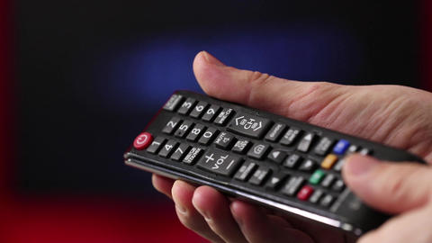 Hand Hold Tv Remote Control. Tv On The Background Footage