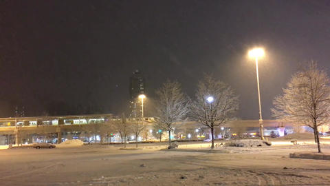 Motion of passing skytrain on cold blizzard snow winter night with 4k resolution Footage