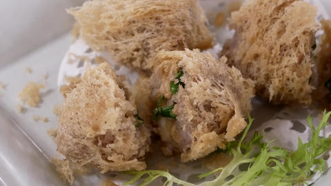 Pan shot of dim sum on table inside Chinese restaurant with 4k resolution Live Action