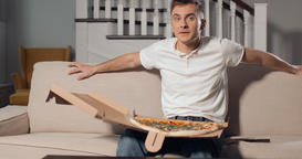 Excited Man Watching Tv and Eating Pizza Footage