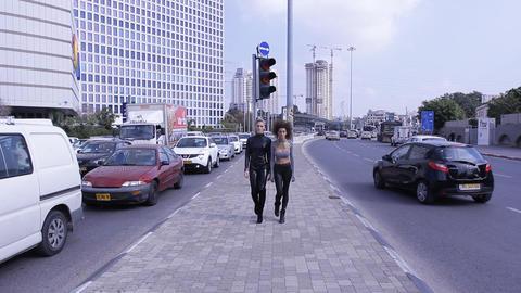 sexy fashion UFO alien couple robotic street walking Stock Video Footage