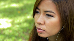 Young Woman Enjoying Listening to Music on her Headphones Stock Video Footage