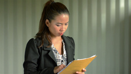 Young Businesswoman Frustrated Reading Documents Stock Video Footage