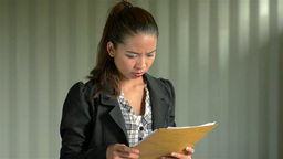 Young Businesswoman Frustrated Reading Documents Footage