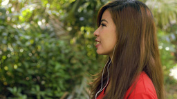 Woman Enjoying Listening to Music on Headphones Smiles at... Stock Video Footage
