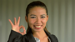 Young Asian Businesswoman Giving a Smiling 'OK' sign to... Stock Video Footage