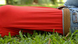Young Woman Relaxing, Lying on the Grass in a Park Stock Video Footage