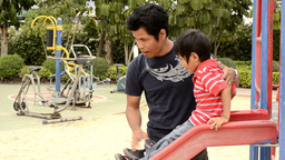 Father and Son on Slide Stock Video Footage