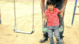 Young Boy Falls off Swing Stock Video Footage