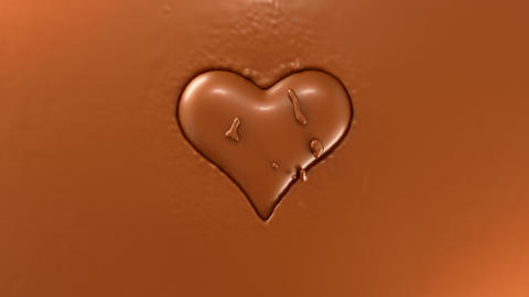 Sweet love: Heart shape splashes on the hot chocolate... Stock Video Footage