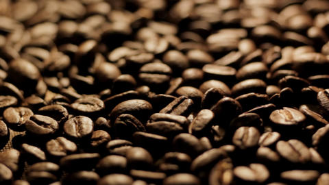 Coffee beans turning close up Stock Video Footage
