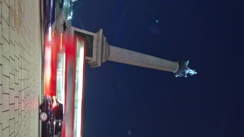 Vertical shot of Tracking time-lapse of Nelson's Column in Trafalgar Square, Lon Footage