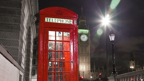Panning shot of Tracking time-lapse of Big Ben behind a telephone booth in Londo Footage