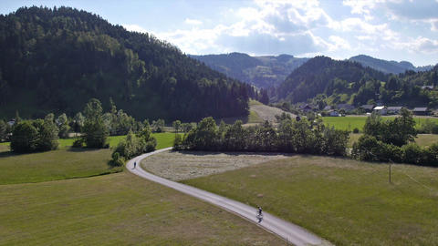 Aerial - Cyclists cycling on a curved road Footage