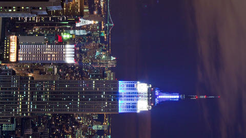 Vertical shot of The Empire State Building and New York City night time-lapse Footage