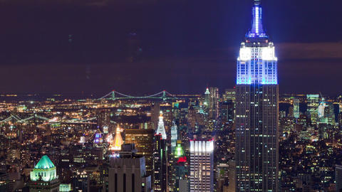 Panning shot of The Empire State Building and New York City night time-lapse Footage