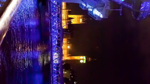 Vertical time-lapse of the London Eye and Big Ben at night Footage