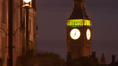 Panning time-lapse of Big Ben with traffic and people in the foreground Footage