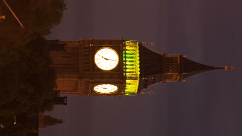 Vertical time-lapse of Big Ben with traffic and people in the foreground Footage