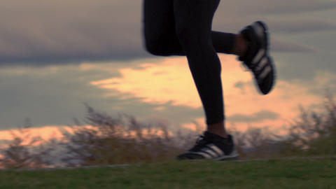 Close up of a running man's feet on a park trail Footage