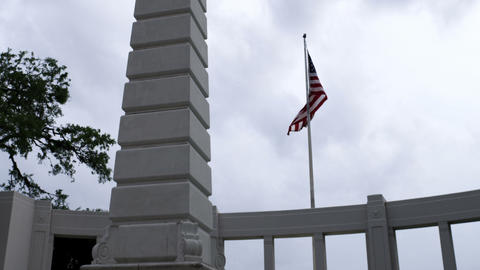 USA flag waving over a monument and marble walkway Footage