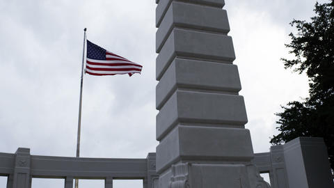 Monument and a waving flag of the USA Footage