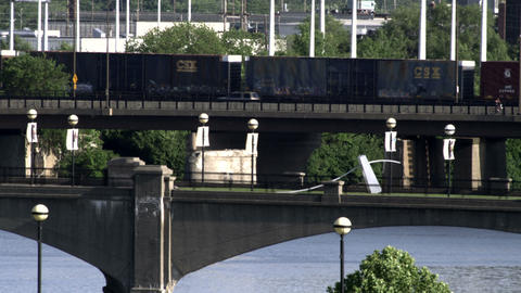 Old train and cars on a bridge over a river Footage