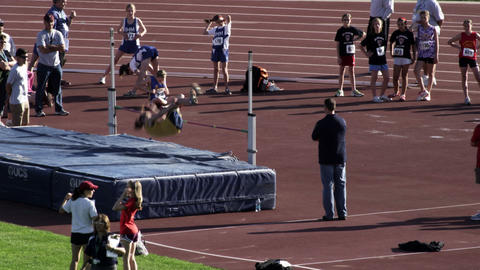 Girl high jumping at a track and field meet Footage